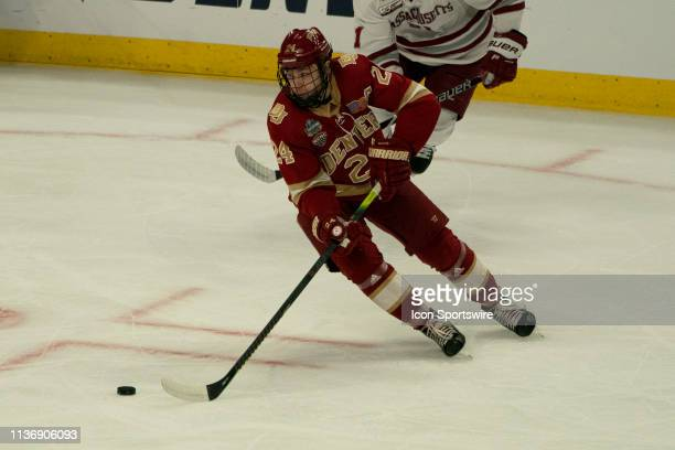 Denver Pioneers Forward Colin Staub skates with the puck during the first period of the NCAA Frozen Four semi-final game between the Massachusetts...