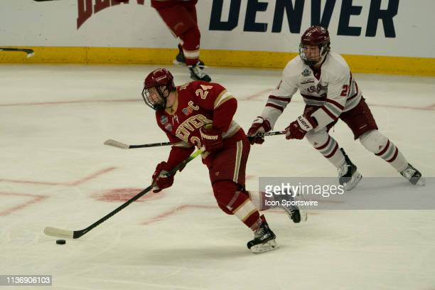 Denver Pioneers Forward Colin Staub skates with the puck with Massachusetts Minutemen Forward Mitchell Chaffee in pursuit during the first period of...