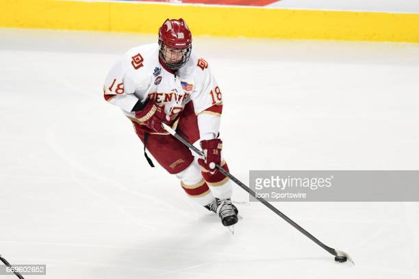 Denver Pioneers forward Emil Romig controls the puck during the NCAA men's national championship game between the MinnesotaDuluth Bulldogs and the...