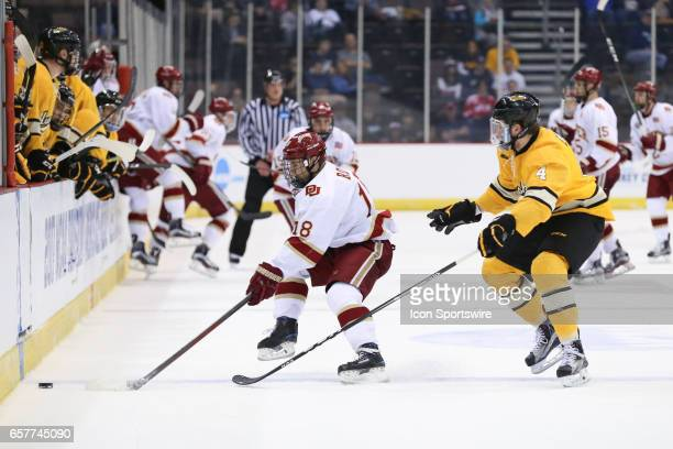 Denver Pioneers forward Emil Romig controls the puck during the Midwest Regional of the NCAA Hockey Championship between the Denver Pioneers and the...
