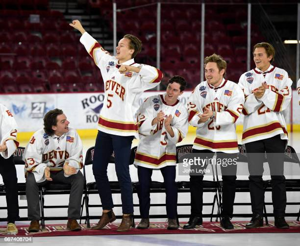 Denver Pioneers forward Henrik Borgström leads the team in a song during the Denver Pioneers men's hockey team celebration with the fans on April 11...