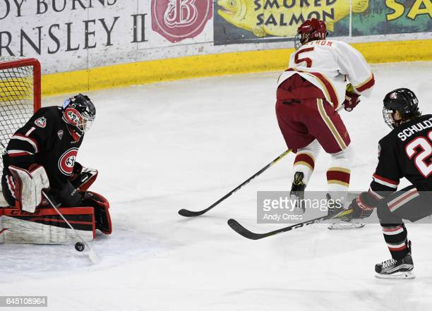 Denver Pioneers forward Henrik Borgström makes a behindtheback pass in front of St Cloud State Huskies goalie Jeff Smith for an assist to Denver...