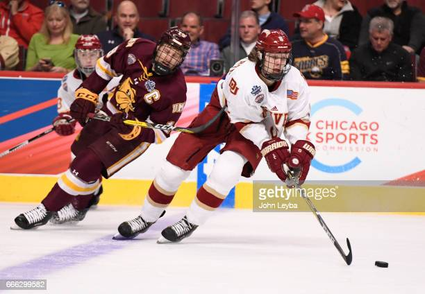 Denver Pioneers forward Henrik Borgström steals the puck from MinnesotaDuluth Bulldogs center Dominic Toninato during the first period of the NCAA...