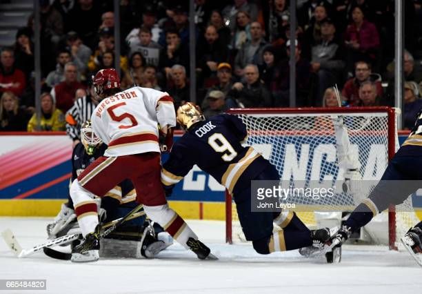 Denver Pioneers forward Henrik Borgström takes a shot on Notre Dame Fighting Irish goalie Cal Petersen for a score during the first period April 6...