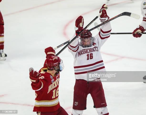 Denver Pioneers Forward Jake Durflinger and Massachusetts Minutemen Defenseman Cale Makar get tangled up during the NCAA Frozen Four men's hockey...