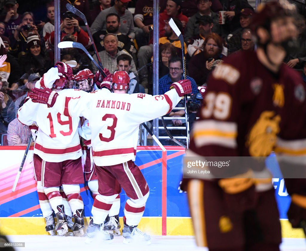 Denver Pioneers forward Jarid Lukosevicius (14) celebrates his third goal with Denver Pioneers forward Dylan Gambrell (7) Denver Pioneers defenseman Tariq Hammond (3) and Denver Pioneers forward Troy Terry (19) during the second period against the Minnesota-Duluth Bulldogs of the NCAA Men's Ice Hockey Championship on April 8, 2017 in Chicago, Illinois at the United Center.