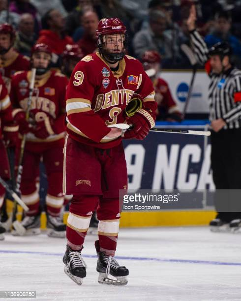 Denver Pioneers Forward Tyson McLellan skates out on the ice after a timeout during the second period of the NCAA Hockey Frozen Four semi-final game...