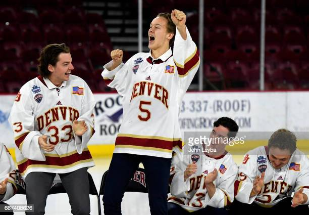 Denver Pioneers goalie Patrick Munson and Denver Pioneers forward Henrik Borgström lead the team in a song during the Denver Pioneers men's hockey...