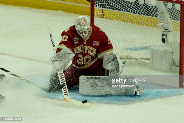 Denver Pioneers Goaltender Filip Larsson makes a stick save during the first period of the game between the Massachusetts Minutemen and the Denver...