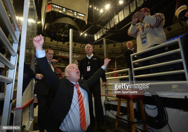 Denver Pioneers Head Coach Jim Montgomery celebrates with the fans after the NCAA men's national championship game between the MinnesotaDuluth...