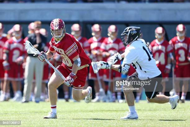 Denver Pioneers midfielder Colton Jackson and Providence Friars midfielder David Procopio during a college lacrosse match between Denver Pioneers and...