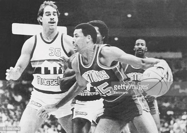 Piston player John Long attempts to drive for the lane on Nugget player Richard Anderson