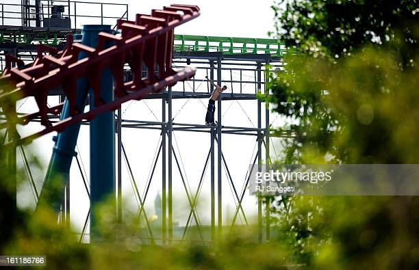 Denver Police and Fire rescue a man who has climbed to the top of the Sidewinder roller coaster Monday June 25 at Elitch Gardens The park remains...