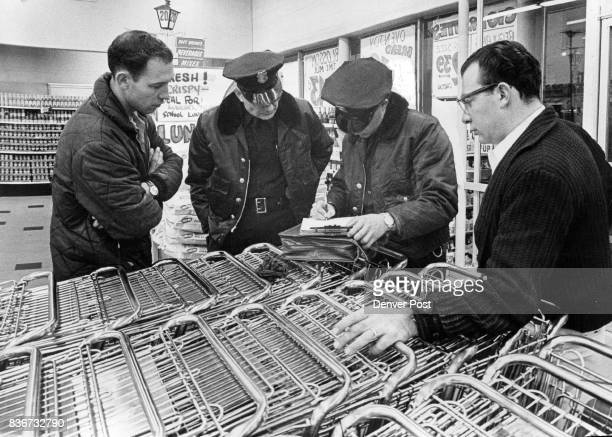 Denver Police Check Monday Holdup At Safeway Store From left are Allen Rein store employe Acting Sgt V Tampa Patrolman H E Dressel and Frank Zarlengo...