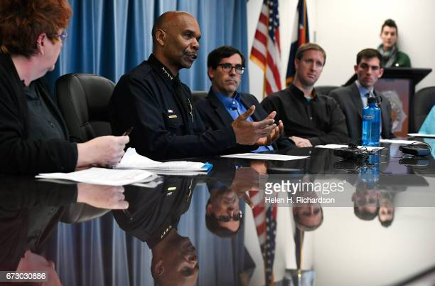 Denver police chief Robert White second from left addresses questions posed to him by members of People Power to talk about the department's policy...