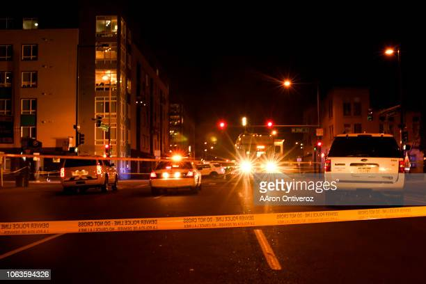 Denver Police Department work the scene of a shooting at 21st and Lawrence on Monday November 19 2018 Police are investigating a shooting in Denvers...