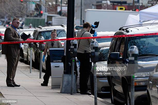 Denver police investigate an officer involved shooting on Bannock St between 13th and 14th st April 12 2016