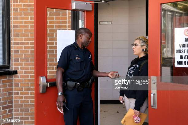 Denver Police Officer Bernard Henry school resource officer for DCIS Montbello High School in Denver and senior Sayra Cervantes in the doorway of the...