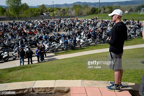 Denver Police Officer John Adsit looks down on the hundreds of bikers at Columbine High School Bikers take part in the 2nd Annual MC1 Honor Run May 3...