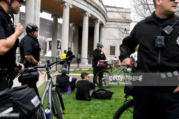 Denver Police officer Tony Gutierrez cites Zach and Nathen for smoking marijuana in public during 4/20 festivities at Denver's Civic Center Park on...