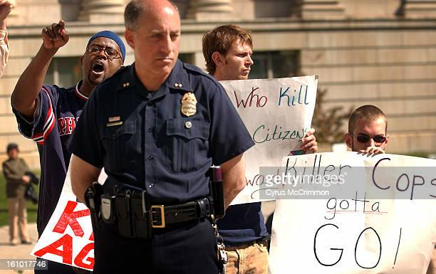APRIL 19 2004 Denver Police officers gathered on the steps of Denver's City and County Building to show their support for suspended officer James...