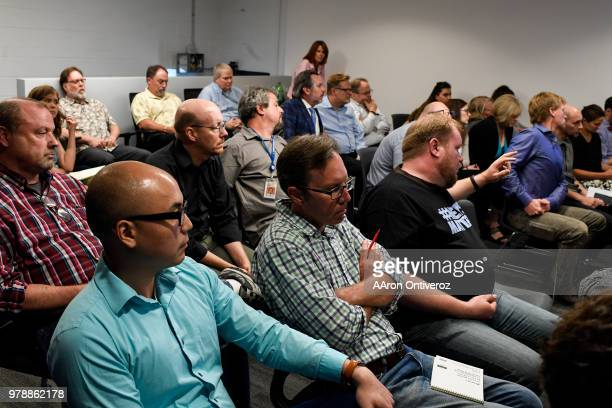 Denver Post editorial employees listen as Joe Fuchs chairman of Digital First Media and Guy Gilmore COO address the about the state of the company...