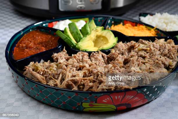 Denver Post features editor Barbara Ellis' Easy Slow cooker Pulled Pork complete with avocados salsa sour cream and cheese at the Denver Post studios...