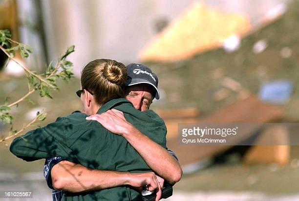 Denver Post photo by Cyrus McCrimmon 8/29/02 Aurora resident John Pigman is hugged by his girlfriend Jennifer Swayze at his condo unit at Moon Shadow...