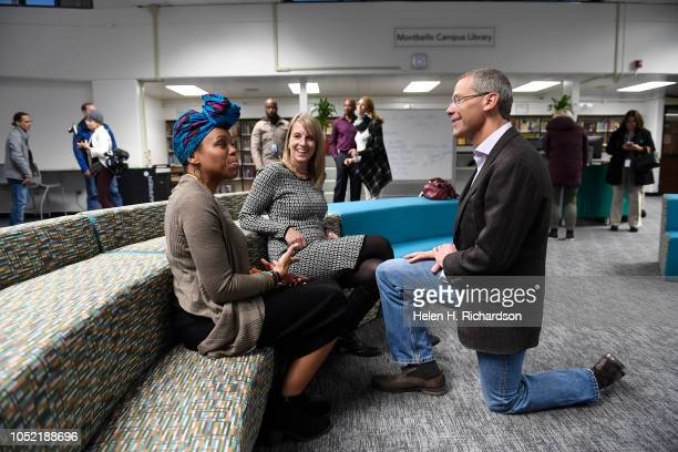 Denver Public Schools superintendent Tom Boasberg right chats with Montbello teacher librarian Julia Torres left and DPS director of library services...