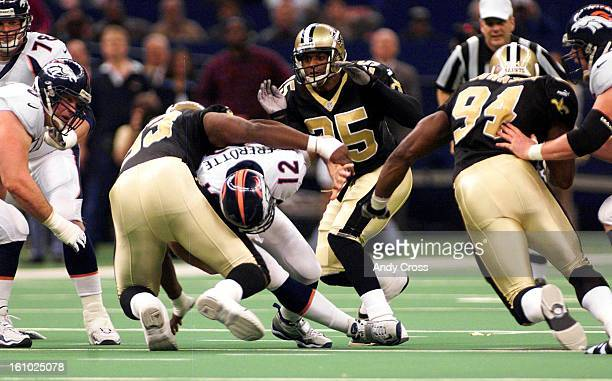 VS SAINTS Denver QB Gus Frerotte gets sacked by Darren Howard #93 New Orleans Saints in the second quarter of play at the Louisiana Superdome Sunday...