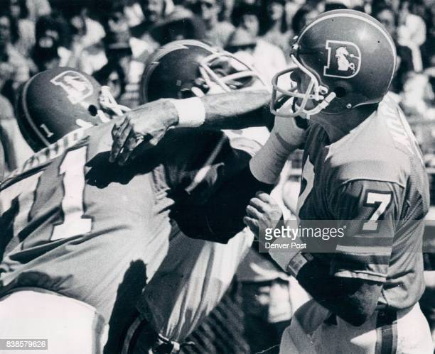 Denver quarterback Craig Morton unloads a pass over a charging Charger in Sunday's National Football league game at Mile High Stadium Bronco left...