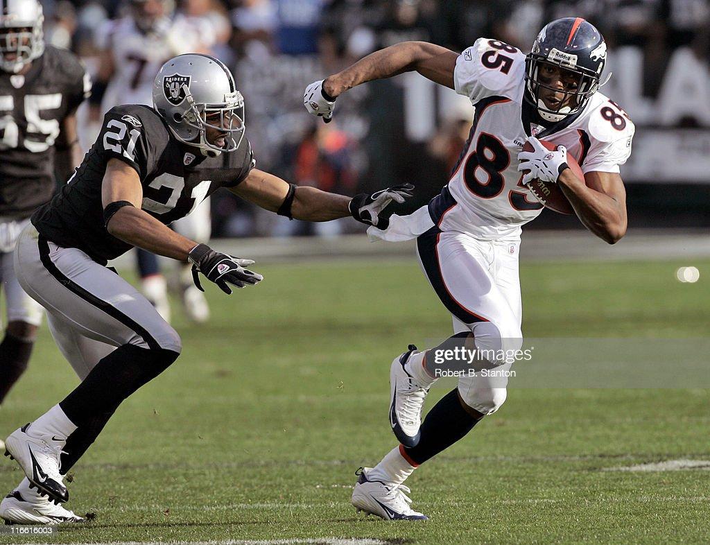 Denver receiver Ashley Lelie tries to get around Oakland cornerback Nnamdi Asomugha as the Denver Broncos defeated the Oakland Raiders by a score of 31 to 17 at McAfee Coliseum, Oakland, California, November 13, 2005.
