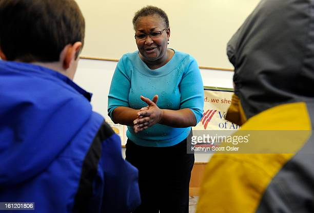 Denver singer Hazel Miller joins local preschool and kindergarten children at the Blair Caldwell Library on Friday Feb 10 2012 to help celebrate...