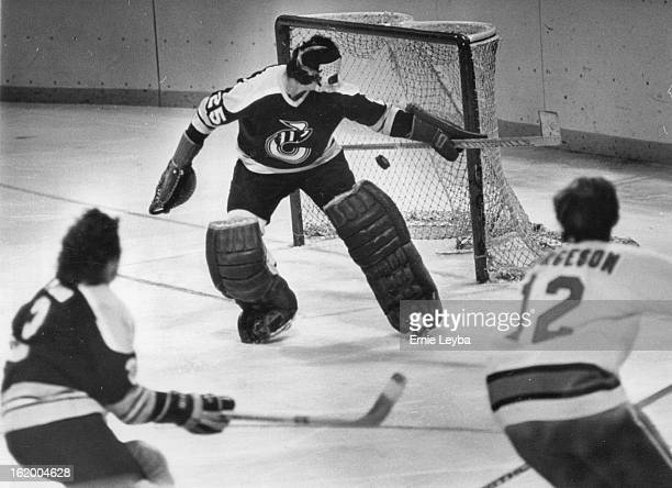 Denver Spurs ; Looked like a goal but wasn't goalie blocked it John Kiely blocks shot lay Don Borgeson ***** Stinger defenseman Ron Plumb comes in...
