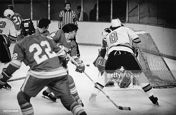 Denver Spurs ; Near miss on ***** goal - 1st period; One of the Near-Misses for Spurs in Omaha Game; Mitch Babin of Denver watches his shot go awry...