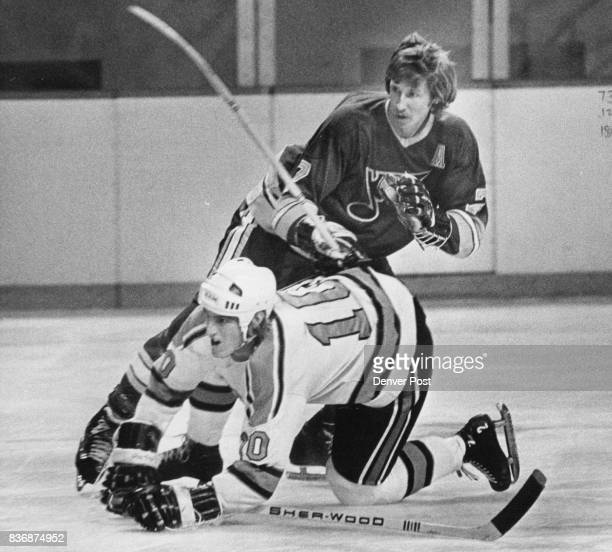 Denver Spurs St Louis Spurs 1st Period Action Garry Unger Center Ges Lower Def Over My Dead Body George Fowler of the Denver Spurs appears to be...