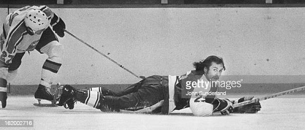 FEB 19 1975 2201975 Denver Spurs Tulsa Oilers' Gene Sobchuk Gets Unscheduled 'Rest' Sobchuk hit the ice after scramble for loose puck with Denver's...