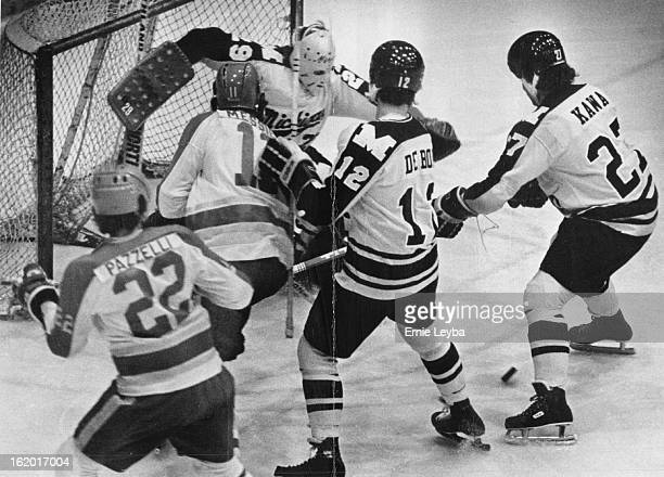 JAN 30 1978 Denver University Athletics Ice Hockey QuickFooted Goalie Foils Pioneer Scoring Attempt Michigan goalie Rudy Varvari kicks away shot by...