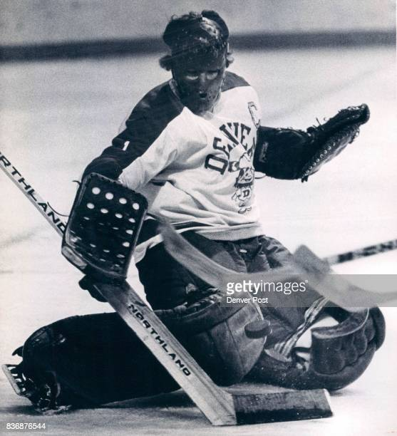 Denver University * Ice Hockey DU knee pad Saves Like this Made it Easy for DU to Take Title Pioneer Ron Grahame is shown making one of his 31 saves...