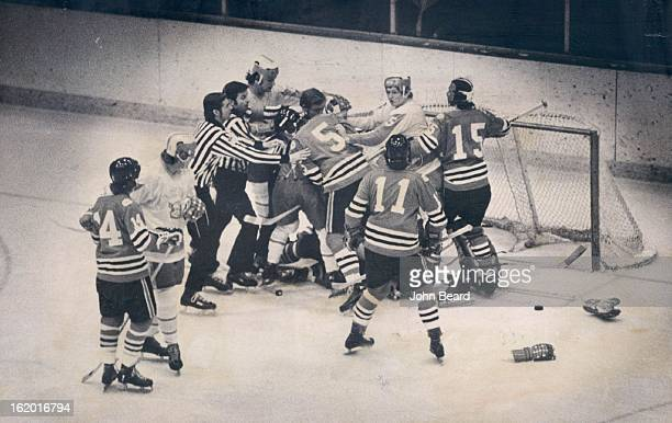 FEB 16 1974 FEB 18 1974 Denver University Ice Hockey Hockey Puck is Forgotten Item as 'Boxing' Takes Over at DU Arena Gloves sticks litter ice as...