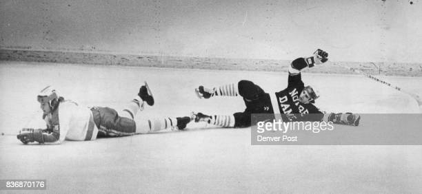 Denver University * Ice Hockey Hockey's Siamese Twins DU's Pete McNab and Notre Dame's Eddie Bumbacco had their skates locked The game had to be...