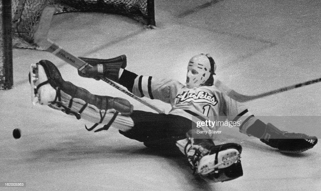 DEC 6 1974, DEC 7 1974; Denver University - Ice Hockey (Action); Just Follow the Bouncing Puck; Mich : News Photo