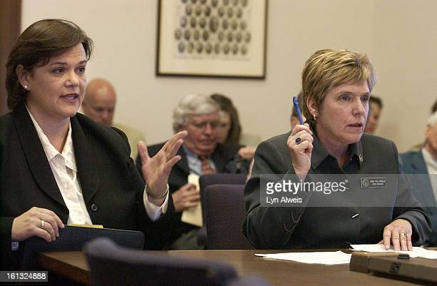 March 31, 2004- JoAnn Groff President of the Colorado Retail Council and Colorado Senator Joan Fitz-Gerald <cq> both raise their hand to be...