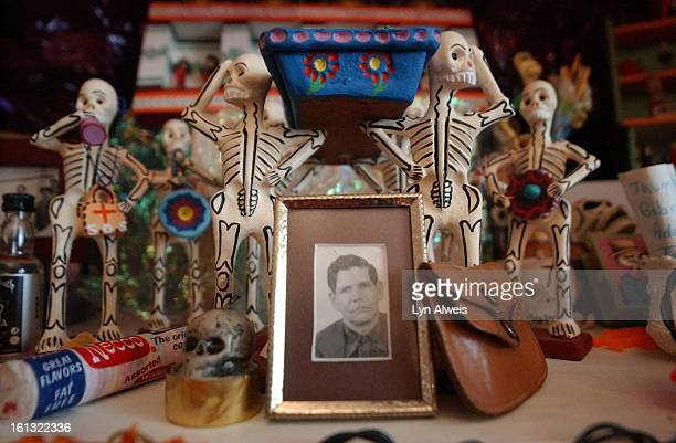 October 162003Florence HernandezRamos <cq>has a large Day of the Dead altar in her living room On one shelf is a photo of her grandfather Luis...