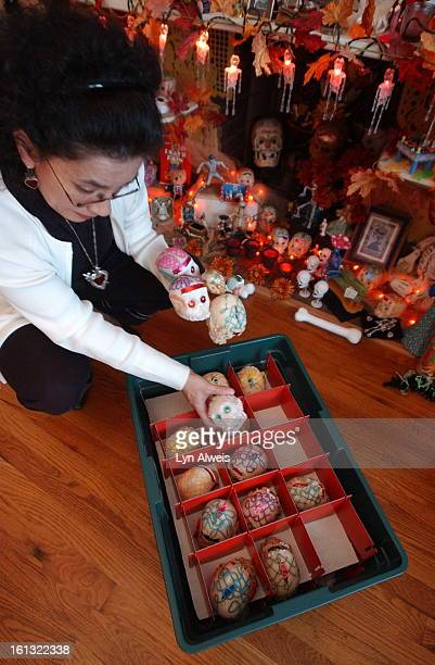 October 162003Florence HernandezRamos <cq>has a large Day of the Dead altar in her living room These are the calaveras<cq> de azucar<cq> or sugar...
