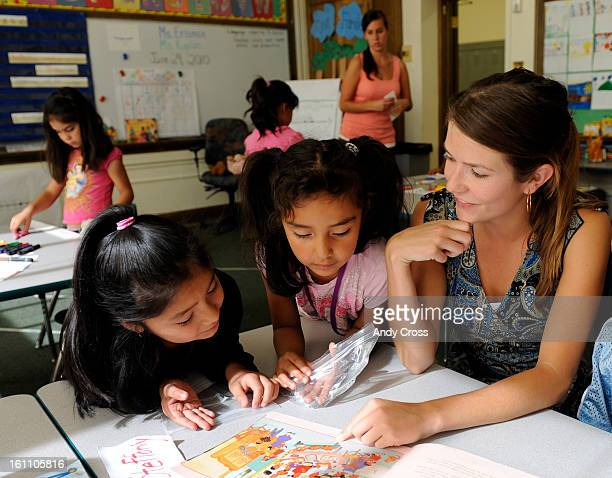 COMaster teacher Lindsey Erisman right works with students Magali Alvarado 6yearsold left and Dianis Morales Mendoza also 6yearsold in an English...