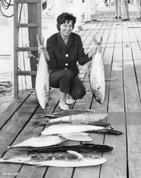 Denverite Successful Dorothy Rich of Denver displays a 15pound amberjack and several other fish she has entered in the Metropolitan Miami Fishing...