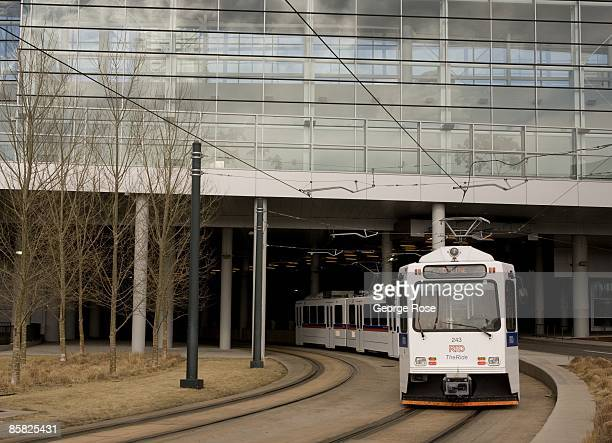 Denver's light rail commuter train is seen coming out from a tunnel under the Convention Center in this 2009 Denver Colorado spring cityscape photo