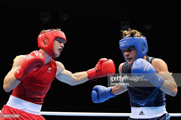 Denys Berinchyk of Ukraine in action against Jeffrey Horn of Australia during the Men's Light Welter Boxing quarterfinals on Day 12 of the London...