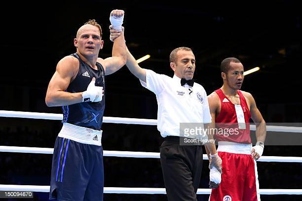 Denys Berinchyk of Ukraine reacts after he was declared the winner against MunkhErdene Uranchimeg of Mongolia during the Men's Light Welter Boxing...